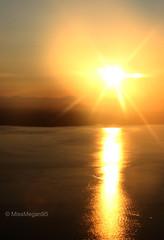 (212/234) Day's End (MissMegan95) Tags: seattle light sunset reflection nature water beautiful sunshine vertical airplane landscape flying washington scenery view bright dusk aerial pugetsound seatac breathtaking shimmer glisten