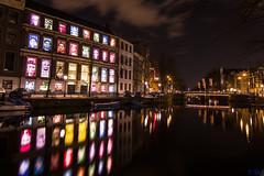 Colors of Amnesty (carolina_sky) Tags: color reflection amsterdam night citylights amnestyinternational blinkagain bestofblinkwinners coymanshouse