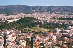 When Ancient Athens meets the Modern World. (The Michaelangelo's.) Tags: panorama buildings ruins athens greece avenue greekcivilization analoguephotography