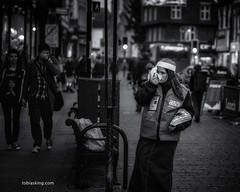the big tissue (Toby King) Tags: christmas street xmas city portrait nose town big candid tissue streetphotography social blow wipe society issue seller