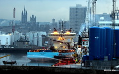 The hose job at the harbour (mootzie) Tags: blue sea skyline lights scotland haze workers harbour ships storage hose cranes aberdeen activity jackets tanks visibility