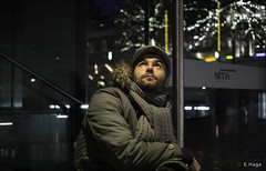 Waiting for his Valentine (zilverbat.) Tags: winter walter portrait people urban cold love dutch face hat pose model dof nightshot image bokeh thenetherlands dramatic denhaag valentine area pancake wintertime portret centrum zone streetshot urbanlife htm valentijn grot