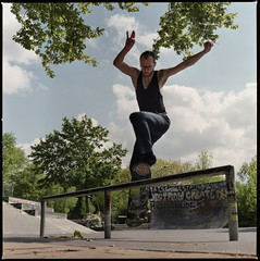 """I ain't goin' to work today ... cuz i'd rather work on breakin my own bones with some style!"" (Konrad Winkler) Tags: 6x6 tattoo graffiti skateboard skater grind mittelformat fujipro400h berlinneuklln hasselblad503cx"
