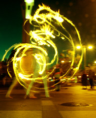 Poi Fire Dancer, Dragon Light Trails (shaire productions) Tags: sf sanfrancisco longexposure light people lightpainting night painting fire person photography evening photo dance experimental pattern dragon dancing circles picture experiment dancer flame photograph elements poi lighttrails shape circular imagery