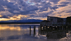 boatshed drama (rina sjardin-thompson photography) Tags: newzealand sky cloud reflection water weather rural sunrise nz southisland wilderness westcoast southernalps westland okarito boatshed waterscape okaritolagoon southwestland rinathompson rinasjardinthompson