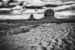 Monument Valley B&W (CARLORICCI) Tags: red arizona blackandwhite bw panorama usa monochrome clouds america landscape utah sand nikon cowboy desert indian grandcanyon unitedstatesofamerica valley carlo 24mm navajo redrock nikkor monumentvalley plain ironoxide stagecoach biancoenero oldwest desertsouthwest ombrerosse diligenza nikond700 nikkor2470f28 americanwestern copyright carloricci riccarlo carl ocarlo