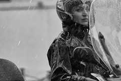 Rider in the storm (thesilvercitizen) Tags: woman rain streetphotography scooter thunderstorm raining panning rider speeding thelook blackwhitephotography raincover photoftheday yourshot canonuk