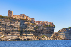 (Voyages Lambert) Tags: old travel blue sea summer sky cliff house seascape france history beach nature water architecture outdoors island town europe cityscape village fort corsica medieval coastline scenics mediterraneansea bonifacio landscaped urbanscene famousplace buildingexterior mediterraneanculture frenchculture stonematerial rockobject