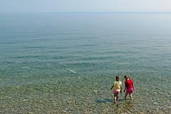 """Like Mermaids, Returning to the Sea"" - Piran, Slovenia (TravelsWithDan) Tags: girls water children candid streetphotography slovenia piran wading adriaticsea"