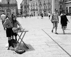 Manualidades (miguelangelortega) Tags: street plaza blackandwhite bw blancoynegro square italia fuji streetphotography chicas fujifilm nias mujeres sicilia siracusa ortigia fotografacallejera x100s
