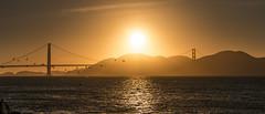 Golden Sunset (Squid Rings (John Burland)) Tags: ocean bridge sunset sea sun kite golden gate san francisco surfer pelican structure hills beac