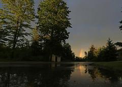 Double rainbow... Kinda (GLC 392) Tags: life trees light sky reflection water grass rain mi evening amazing rainbow pond michigan awesome vivid double bow storms pure ludington