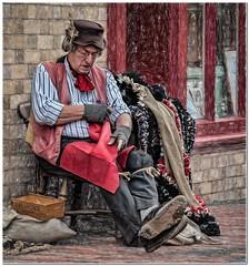 The rag rug maker (Hugh Stanton) Tags: window hat scarf chair rags tools doorway rug waistcoat neckecheif