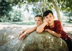 So bored (demandaj) Tags: f2 nikon d4 socal ca losangeles park green trees shade outside explore kids bored portrait natural vsco