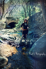 Mistress Fogg (Red 5 Photography) Tags: bridge trees nature fashion creek forest river outdoors skull belt sticks woods stream legs branches tunnel jewelry tribal boulder brunette medicinewoman mistress modelpose fogg steampunk blackdress brownhair talltrees wildwoman skullnecklace standingpose foggcouture
