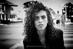 Rafael Rogue (#42) (dksmediasolutions) Tags: california ca portrait blackandwhite usa hair losangeles model longhair makeup headshot curly pedestrians crosswalk curlyhair malemodel citystreet misunderstood passersby northuniversitypark dksmediasolutions davidksmith rafaelrogue