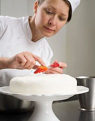 Me putting the finishing touches on a cake! (Dbrooksbank2) Tags: food woman cake cakestand dessert baking holding baker sweet working decoration fresh indoors decorating chef precision whites lookingdown 1person preparing careful frontview skill headandshoulders occupation expertise middleaged 4045years foodanddrinkindustry matureadult commercialkitchen chefsswhites