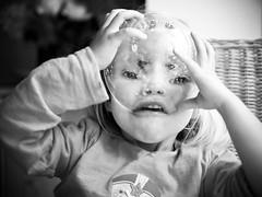 Cereal Bowl Alien (B-Lichter) Tags: portrait bw blur girl monster pen fun lumix blackwhite al crazy funny child availablelight alien olympus explore explored 2514 panaleica epl3