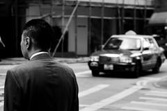 Wait (H_mpus) Tags: street blackandwhite man hongkong waiting cab behind hurry lprestless