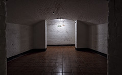 Progress of Sorts (The New Motive Power) Tags: light shadow sea brick glow moody arch fort empty room military victorian corridor symmetry historic isleofwight solent portsmouth fortress nomansland defence canon7d
