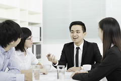Business Meeting (Elvin Cheng) Tags: portrait people woman man male cup water glass coffee beautiful smiling businessman shirt female pen table asian happy office team sitting looking adult working chinese handsome meeting communication business suit busy document discussion done talking manager youngadult showing organization partnership youngwoman youngman cooperation confidence 20s officeworker occupation fourpeople businesswoman businessperson whitecollarworker businessrelationship