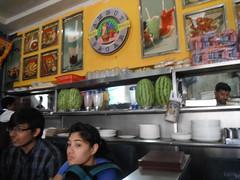 DOSAI JOINT (RubyGoes) Tags: blue food woman india man green yellow bread glasses indian cook watermelon staff bombay maharashtra plates snacks juices mumbai shelves customers bandra vadapav amrutsagar