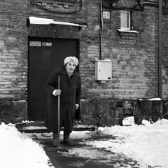 Poetry in Snipiskes yard (ted.kozak) Tags: portrait bw 6x6 film wall square delete5 delete2 bricks save3 delete3 save7 save8 delete delete4 save save2 save4 oldwoman save5 olga save6 rodinal lithuania vilnius 59 satsuma kozak handdeveloped bronicasqa environmentalportraiture snipiskes zenzanonps80mmf28 tedkozak tadaskazakevicius wwwtedkozakcom