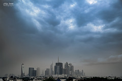The Calm before the Storm (V I J U) Tags: city rain architecture clouds dubai uae canon5d skyscrapper canonef24105mmf4lisusm burjkhalifa vijujose