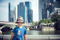 nathan at marina bay (Philippe Put) Tags: city boy cute smile hat skyscraper fun happy kid toddler singapore asia warm child nathan indian handsome sunny caucasian mixedrace fredandginger marinabay