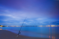 Resting (Gayan Wijesinghe) Tags: blue sunset sea sky beach water evening fishing rod lonely