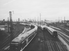 Trains. (christiannass) Tags: world street camera city germany square lens deutschland photography prime photo flickr moments fotografie candid creative samsung scout scene snap best christian explore crop squareformat co moment 18 unposed left tog decisive iphone nass graphy nx5 mmons flickriver iphoneography iphoneonly