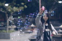 Bubbles everywhere (Dronegraphy) Tags: girl toys bubbles blow blowbubbles