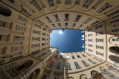 A yard of sky (Pietro Faccioli) Tags: vienna wien door morning blue windows light sky sun sunlight building castle architecture yard court square austria spring swiss perspective royal palace fisheye imperial sunburst walls passage hofburg pietro sunstar schweizerhof faccioli pietrofaccioli