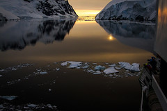 Lemaire Channel _MG_6957  resized (Robyn Aldridge) Tags: sunset sun mountains colour ice water canon reflections landscape outdoors gold rocks wasser antarctica boulders icefloes iceberg icebergs waterscape presunset icescape antarcticpeninsula lemairechannel akademikioffe lrcc pscc canon7d tamron18270mm