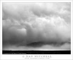 Evening Storms (G Dan Mitchell) Tags: park blackandwhite storm mountains nature monochrome rain clouds landscape evening desert dramatic national deathvalley dust range panamint