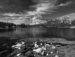 Cathedral Peak, Upper Cathedral Lake (Tony Immoos) Tags: california blackandwhite mountain snow clouds nationalpark yosemite granite