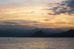 Sunrise over lake Atitlan, Guatemala (Miche & Jon Rousell) Tags: orange lake reflection water sunrise volcano fishing guatemala atitlan sanpedro lakeatitlan sanpedrolalaguna