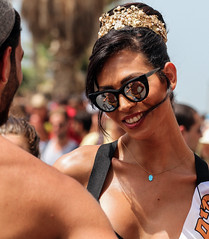 How many tears are hiding behind this flirting lovely smile? (ybiberman) Tags: portrait reflection bicycle israel telaviv candid streetphotography transgender prideparade misstransisrael2016crownsunglassesreflectionhamsa