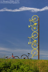 Riding High II (sminky_pinky100 (In and Out)) Tags: portrait sculpture canada art outdoors novascotia uca bicycles unusual clever grandpre eyecatching omot ridinghigh cans2s