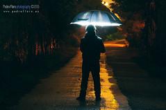 Iluminado bajo la lluvia (Pedro Floro) Tags: red sky colour lana luz night rojo flash rosco cielo nocturna silueta fro acero cathode esfera columpio nighty esphere ctodo