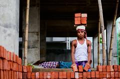 Of Bricks and Labor (Sheikh Shahriar Ahmed) Tags: street red portrait brick digital construction labor environmental dhaka constructionsite bangladesh banasree constructionworker dhakadivision sheikhshahriarahmed