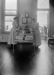 Child and two nurses in Royal Children's Hospital, Melbourne.