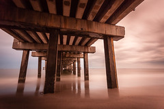 Take Cover (Tim Drivas) Tags: ocean longexposure beach water brooklyn coneyisland pier sand cloudy structure atlanticocean