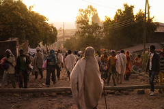Pilgrims (departing(YYZ)) Tags: africa christmas travel sunset people holiday heritage zeiss walking outside religious walk sony christian holy 55mm fe ethiopia alpha spiritual orthodox groupofpeople a7 pilgrim lalibela pilgrims ethiopian robed sonnartfe55mmf18zalens
