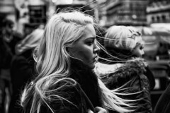 Beautiful blond girl with her hair blowing in the wind      IMG_0557-Edit-Edit (roger_thelwell) Tags: life street city uk winter portrait england people urban bw white black streets cold london lamp monochrome westminster beauty hat rain leather mobile umbrella hair bag walking real photography mono chat shiny phone traffic post natural photos britain circus cigarette candid cab taxi great over sac hats cell photographic smoking lamppost photographs oxford conversation shiney talking shoulder handbag stud speak speaking studs commuters scak beautifulblondgirlwindhair