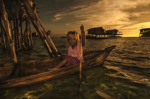 The girl in a wooden boat...