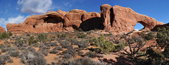 Grand - North Window Panorama (Drriss & Marrionn) Tags: travel red sky cliff usa cloud mountain mountains nature rock clouds landscape utah sandstone skies arch outdoor roadtrip canyon moab blueskies mountainside archesnationalpark lasal rockformation crag northwindow naturalarch