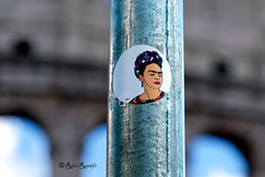 Roma. Street art-sticker art by... Frida Kahlo (R come Rit@) Tags: street city urban italy streetart rome roma muro art wall photography graffiti sticker stickerart italia arte label streetphotography wallart via urbanart labels fridakahlo roadsign walls graff foriimperiali segnalistradali citt graffitiart colosseo muri trafficsignals signposts arteurbana stickerbomb graffitirome italystreetart streetartitaly romegraffiti graffitiroma slapart streetartrome streetartphotography romastreetart streetartroma romestreetart urbanartroma stickervandal ritarestifo signscommunication romeurbanart