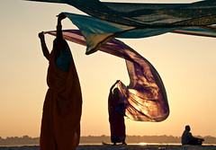 Sari (silvia.alessi) Tags: travel sunset sky people india color colour beautiful silhouette river women asia religion ngc sacred ligth lonelyplanet sari ganga ganges indu kumbhmela incredibleindia