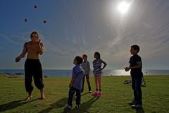 Jaffa (Hemo Kerem) Tags: street blue sea green kids canon israel telaviv sony jaffa mf 24mm juggling alpha juggler manualfocus tlv fd canonfd canonfd24mmf28 a7rii sonya7rm2 a7rm2 ilce7rm2